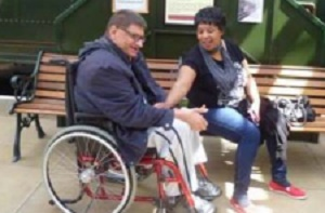 Person in wheel chair with friend