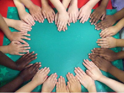 Many hands forming a heart shape